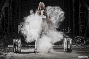 Picture of Woman working out with weights in the gym