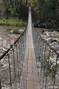 Picture of A long suspension bridge over a river in the maasai mara national reserve;Maasai mara kenya
