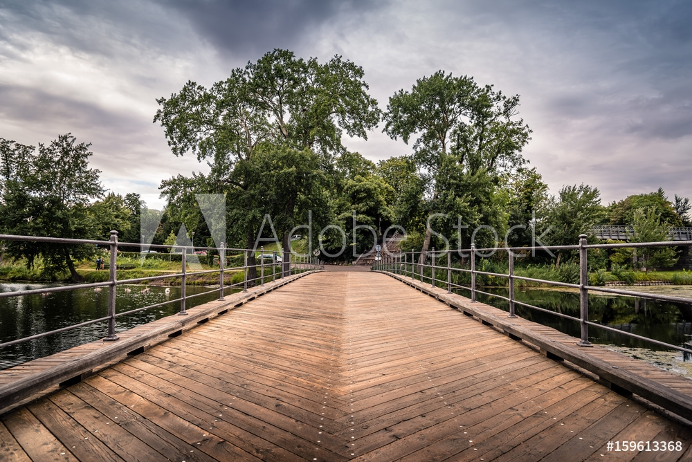 Picture of Bridge over pond in Churchill Park in Copenhagen, Denmark, a cloudy day of summer