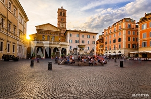 Picture of Basilica di Santa Maria in Trastevere and Piazza di Santa Maria in Trastevere at sunset, Rome, Italy. Trastevere is rione of Rome, on west bank of Tiber in Rome. Architecture and landmark of Rome.