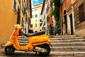 Picture of Orange vintage scooter on the background of Rome street