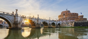 Picture of Holy Angel Bridge over the Tiber River in Rome at sunset.