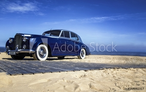 Picture of Beautiful blue retro car on the coast