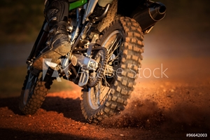 Picture of action of enduro motorcycle on dirt track