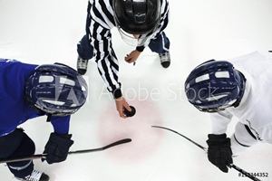 Picture of Directly above shot of referee and two ice hockey players in face-off