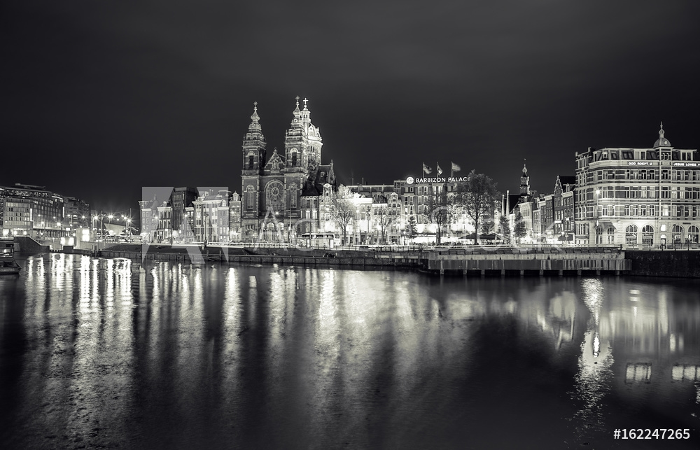 Picture of AMSTERDAM, NETHERLANDS - MAY 25, 2017: General view of Central station of Amsterdam city at night time. Black-white photo. May 25, 2017 in Amsterdam - Netherlands.