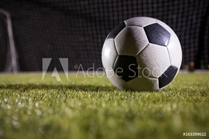 Picture of Close-up of soccer ball on playing field