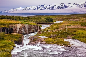 Picture of The creek flows among the flat tundra