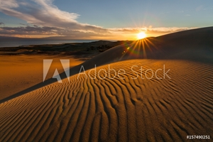 Picture of Picturesque desert landscape with a golden sunset over the dunes